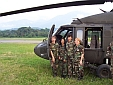 The Girls in Front of a Blackhawk